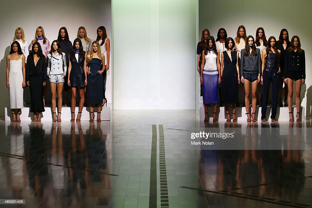 Models pose on the runway at the Christopher Esber show during Mercedes-Benz Fashion Week Australia 2014 at Carriageworks on April 8, 2014 in Sydney, Australia.