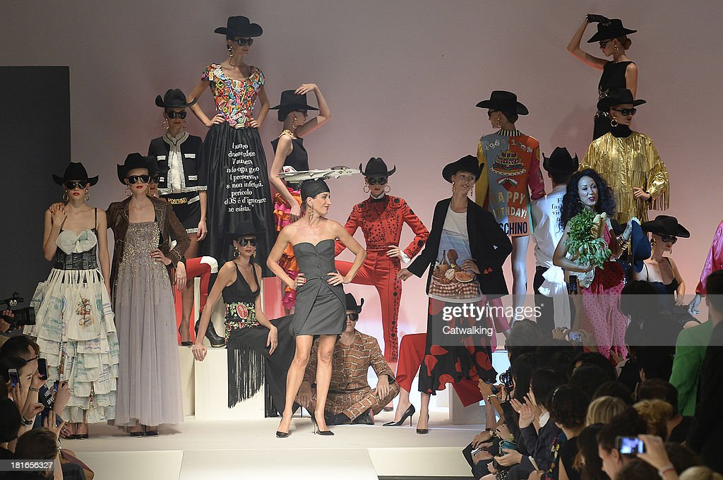 Models pose on the runway at the Moschino Spring Spring Summer 2014 fashion show during Milan Fashion Week on September 21, 2013 in Milan, Italy.