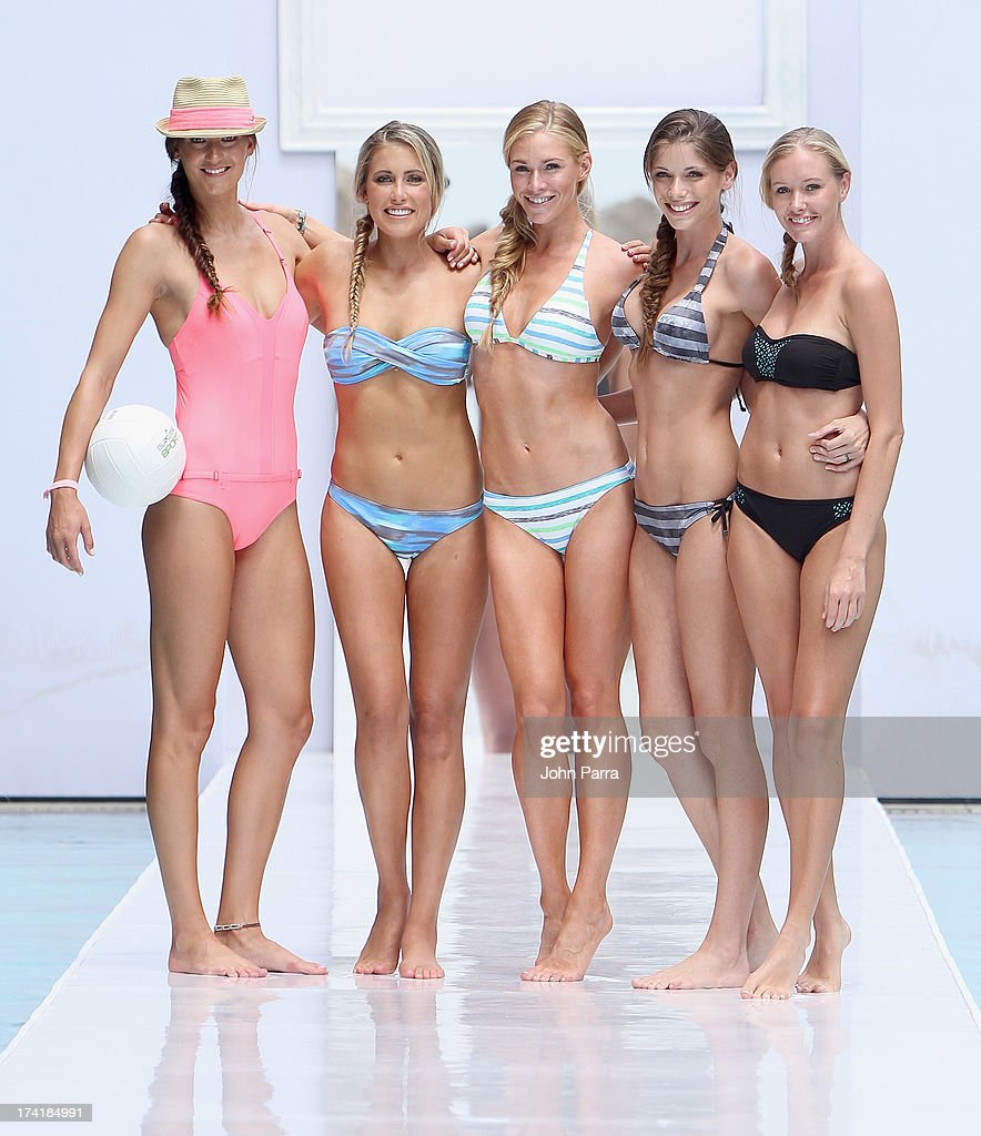 Models pose on the runway at the Oakley show during Mercedes-Benz Fashion Week Swim 2014 at the SLS Hotel on July 21, 2013 in Miami, Florida.