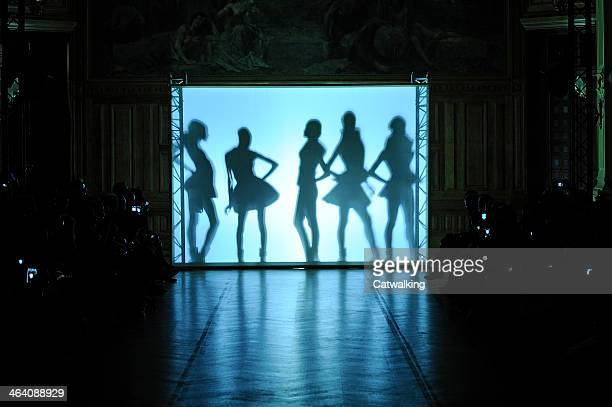 Models pose on the runway at the On Aura Tout Vu Spring Summer 2014 fashion show during Paris Haute Couture Fashion Week on January 20 2014 in Paris...