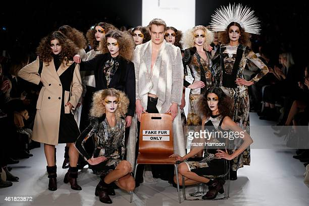 Models pose on the runway at the Rebekka Ruetz show during the MercedesBenz Fashion Week Berlin Autumn/Winter 2015/16 at Brandenburg Gate on January...