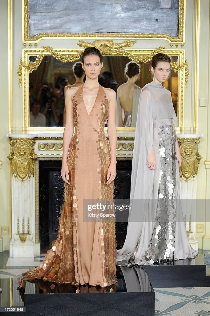 Models pose on the runway during Rami Al Ali show as part of Paris Fashion Week Haute-Couture Fall/Winter 2013-2014 at on July 1, 2013 in Paris, France.