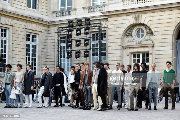 Models pose on the runway during the Berluti Menswear Spring/Summer 2018 show as part of Paris Fashion Week on June 23 2017 in Paris France