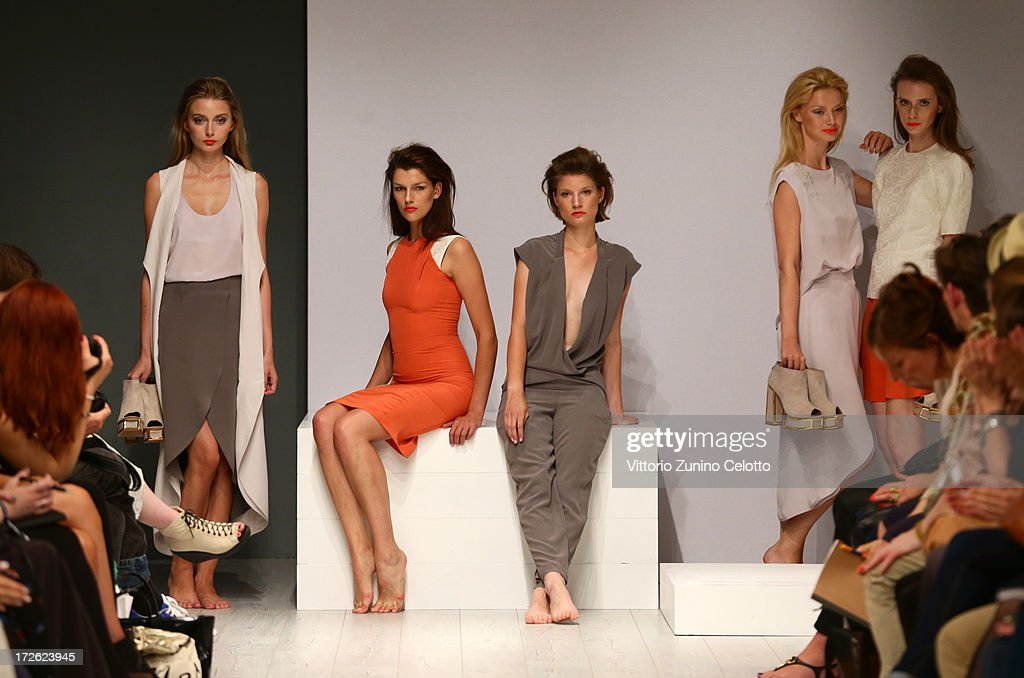 Models pose on the runway during the Isabell De Hillerin Show at the Mercedes-Benz Fashion Week Spring/Summer 2014 at the Brandenburg Gate on July 4, 2013 in Berlin, Germany