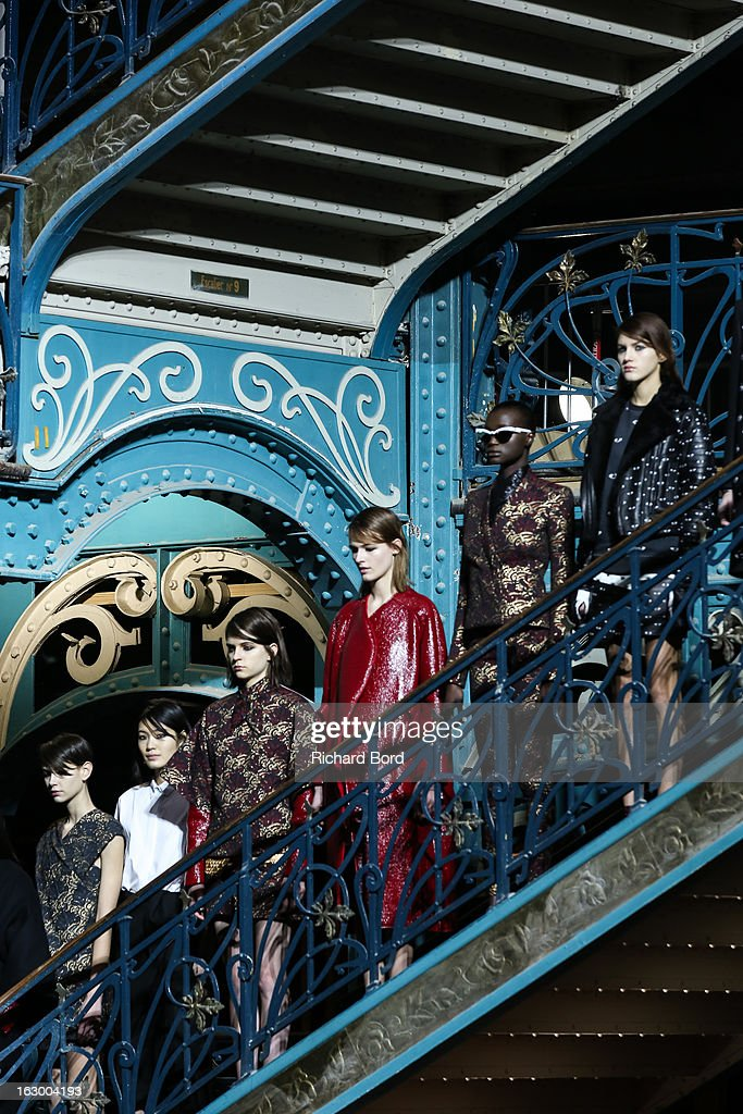 Models pose on the runway during the Kenzo Fall/Winter 2013 Ready-to-Wear show as part of Paris Fashion Week at La Samaritaine on March 3, 2013 in Paris, France.