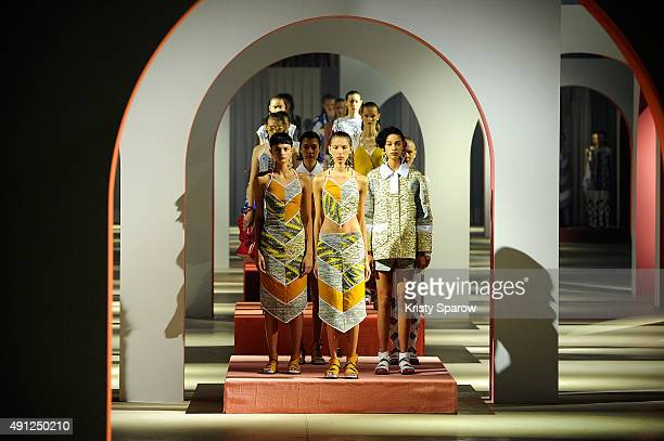 Models pose on the runway during the Kenzo show as part of the Paris Fashion Week Womenswear Spring/Summer 2016 on October 4 2015 in Paris France