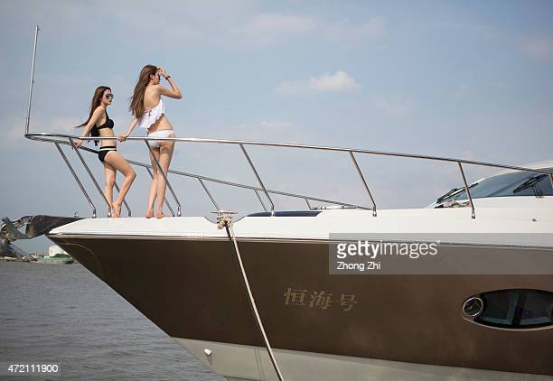 Models pose on the yacht during the Luxury Boat Show at Asian Games City on May 2 2015 in Guangzhou China As the number of Chinese middle class and...