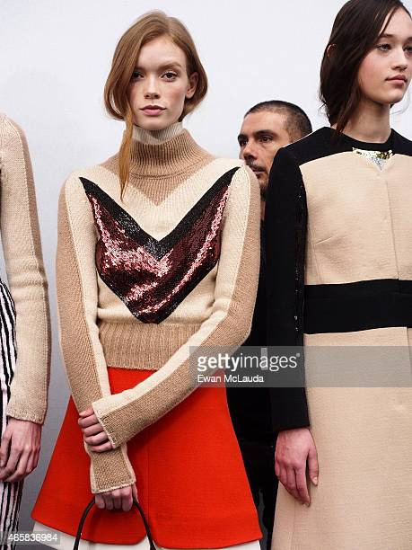 Models pose prior the Giambattista Valli show as part of the Paris Fashion Week Womenswear Fall/Winter 2015/2016 on March 9 2015 in Paris France