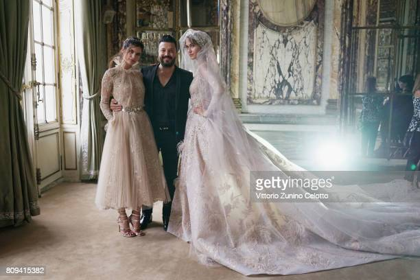 Models pose prior the Zuhair Murad Haute Couture Fall/Winter 20172018 show as part of Haute Couture Paris Fashion Week on July 5 2017 in Paris France
