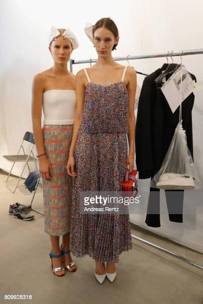 Models pose prior to the Hugo Boss presentation during 'Der Berliner Mode Salon' Spring/Summer 2018 at St Agnes Church on July 6 2017 in Berlin...