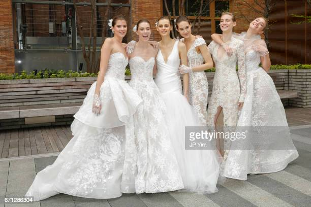 Models pose prior to the Monique Lhuillier Spring 2018 Bridal show at Carnegie Hall on April 21 2017 in New York City