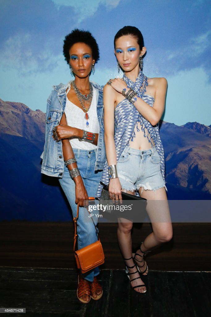 Models pose wearing Dannijo jewelry and handbag at the Dannijo Presentation during MercedesBenz Fashion Week Spring 2015 at The Hosfelt Gallery on...