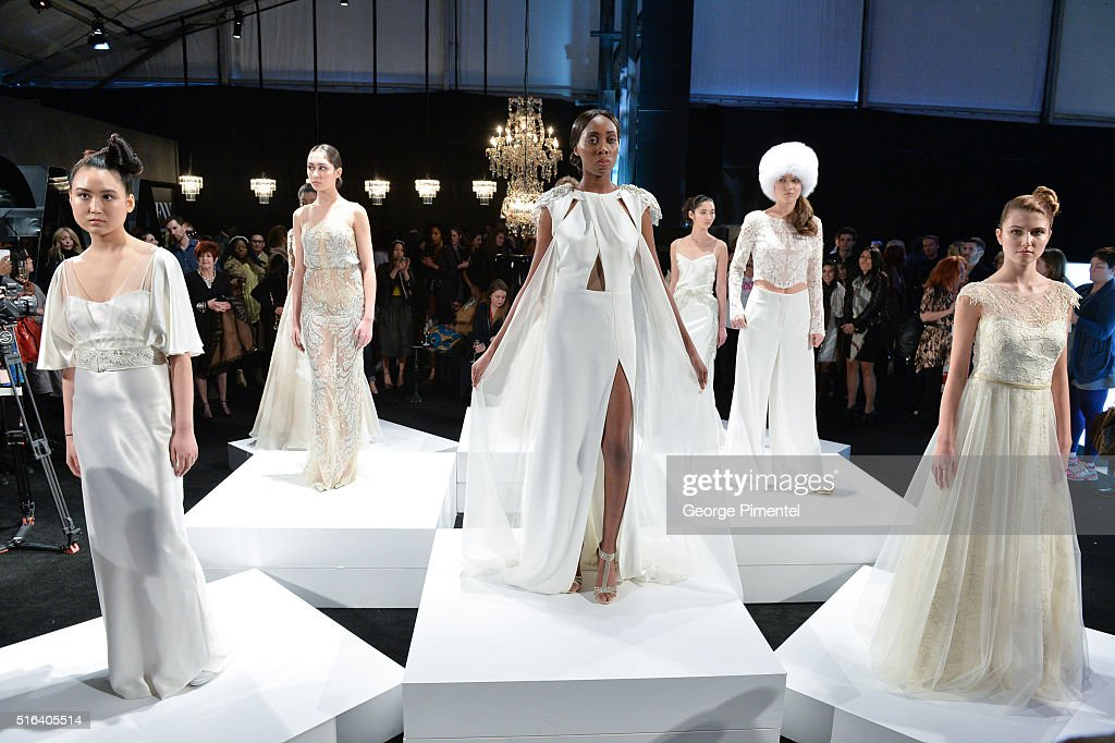 Models pose wearing Di Carlo Couture 2016 collection during Toronto Fashion Week Fall 2016 at David Pecaut Square on March 18, 2016 in Toronto, Canada.