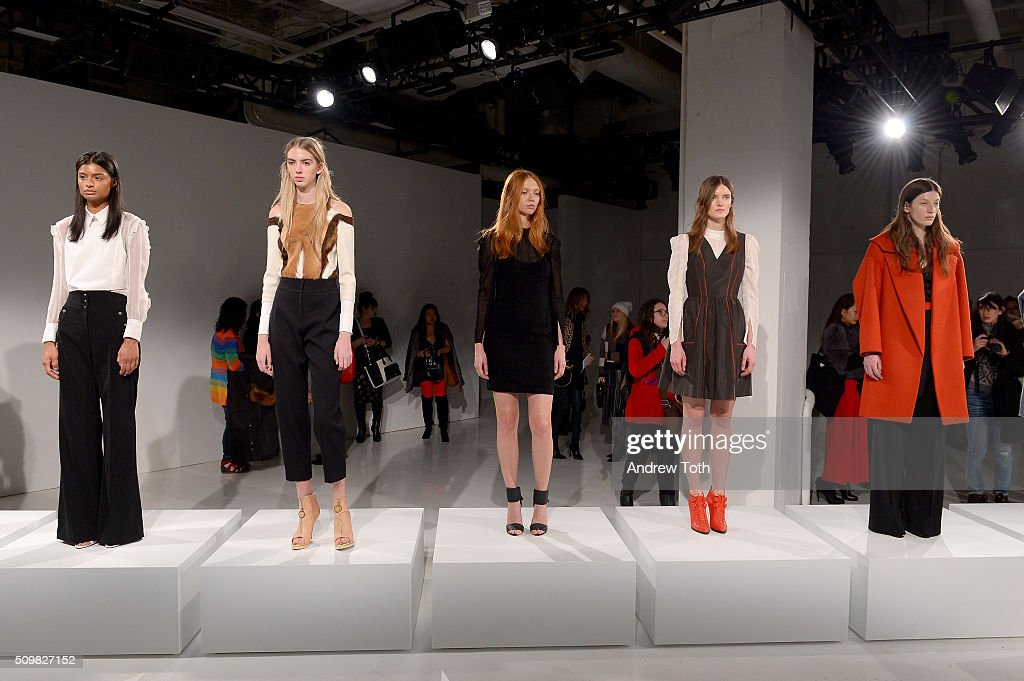 Models pose wearing O'2nd Fall 2016 during New York Fashion Week: The Shows at The Space, Skylight at Clarkson Sq on February 12, 2016 in New York City.
