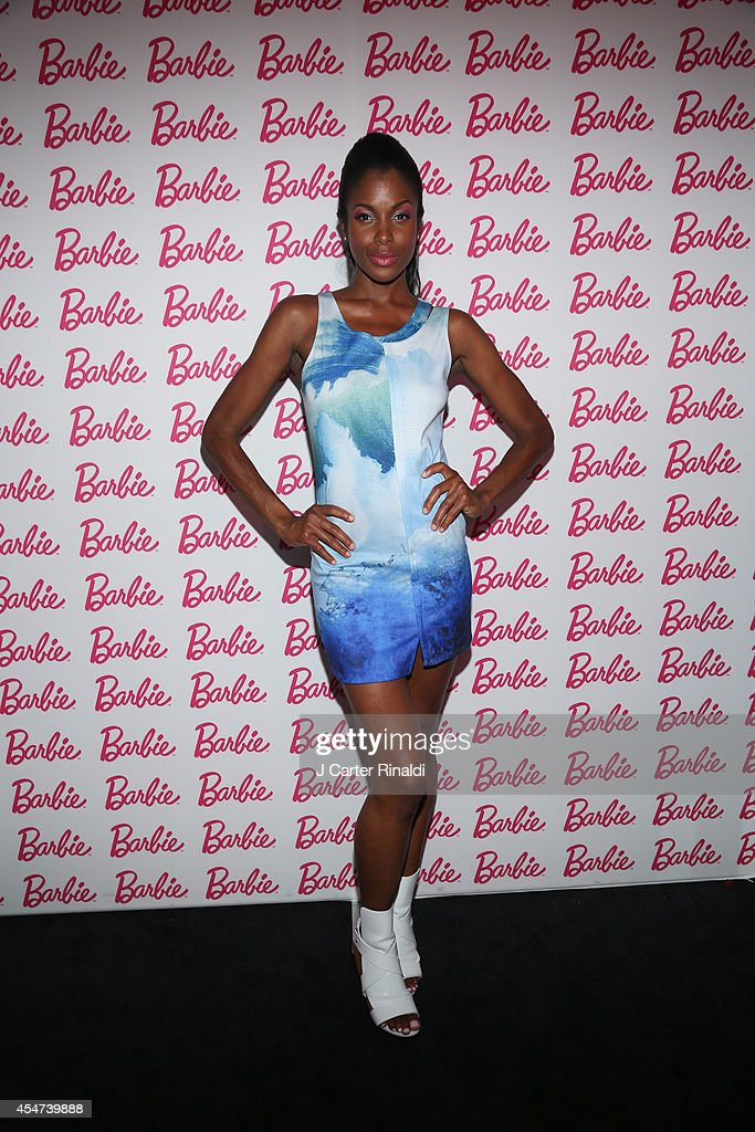 Models pose wearing Tess Giberson design for Barbie at Barbie And CFDA Event on September 5, 2014 in New York City.