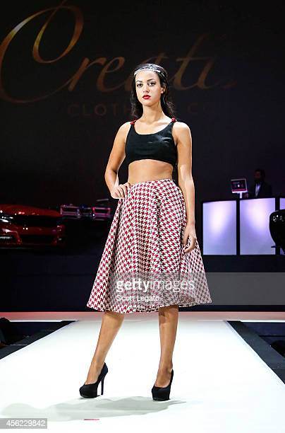 Models pose wearing the Creative Clothing Collection clothing line at The Soundboard Motor City Casino on September 27 2014 in Detroit Michigan