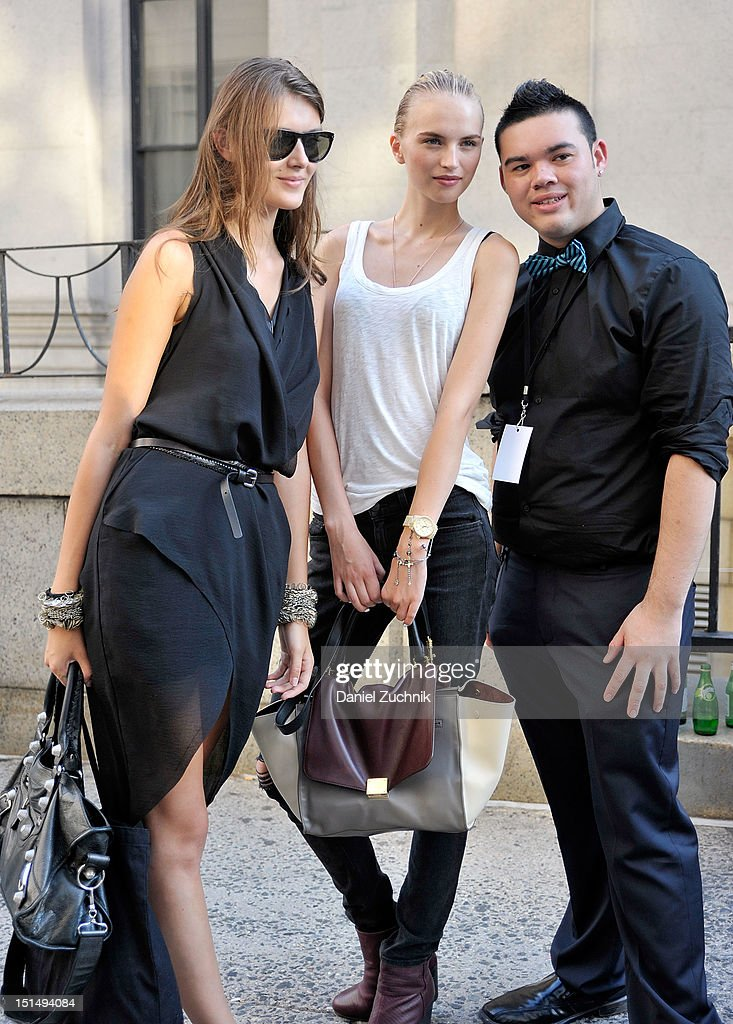 Models pose with a fan outside the Rag and Bone show on September 7, 2012 in New York City.
