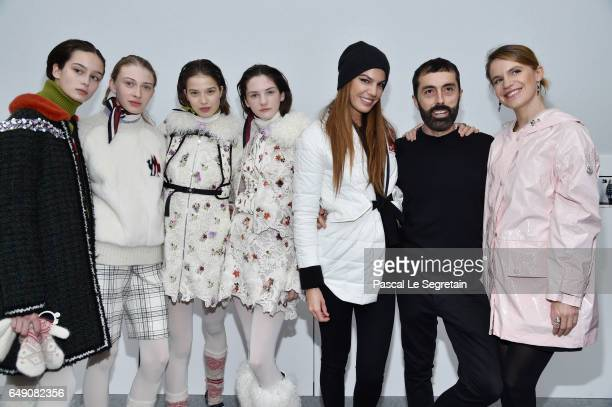 Models pose with Bianca Brandolini d'AddaGiambattista Valli and Eugenie Niarchos after the Moncler Gamme Rouge show as part of the Paris Fashion Week...
