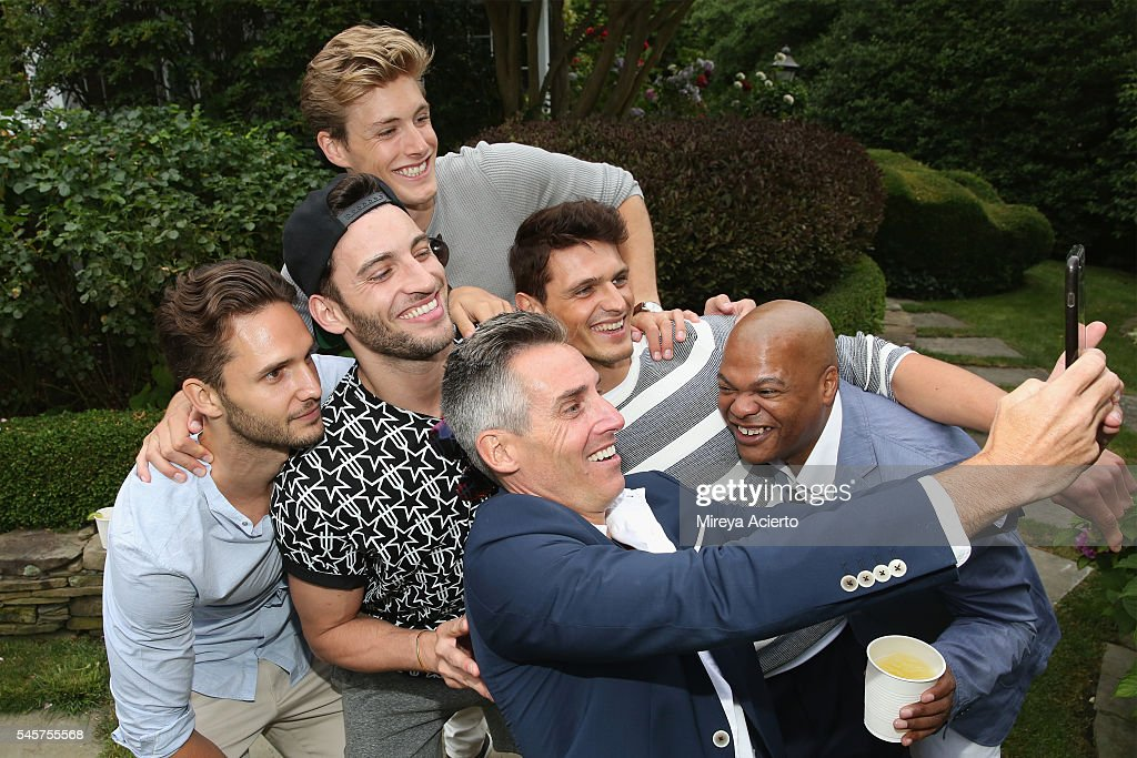 Models pose with chief executive officer of Wilhelmina International Inc Bill Wackermann during Daily Front Row's Boys of Summer party on July 9 2016...