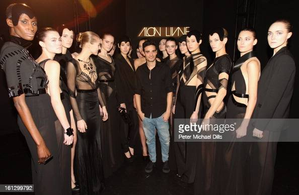 Models pose with designer Alon Livne at the Alon Livne Fall 2013 fashion show during MercedesBenz Fashion Week Fall 2013 Official Coverage Best of...