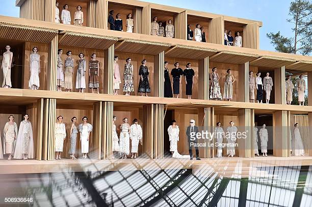 Models pose with designer Karl Lagerfeld as the dome of the Gand Palais is reflected in the phone screen during the Chanel Spring Summer 2016/2017...