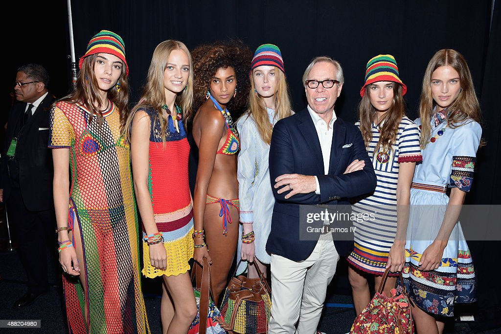 Models pose with designer Tommy Hilfiger backstage at Tommy Hilfiger Women's Spring 2016 during New York Fashion Week The Shows at Pier 36 on...
