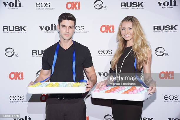 Models pose with eos Lip Balm during the OK Magazine Sexy Singles Party at Amnesia on May 21 2012 in New York City