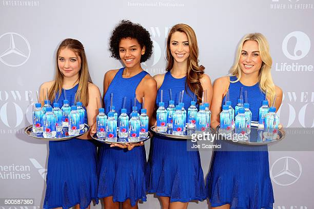 Models pose with Fiji waters the 24th annual Women in Entertainment Breakfast hosted by The Hollywood Reporter at Milk Studios on December 9 2015 in...