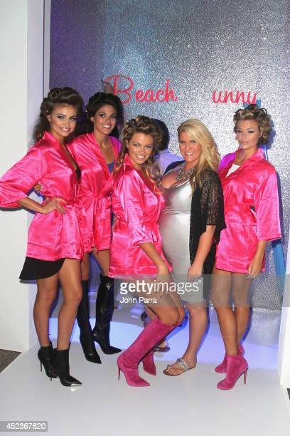 Models pose with guest on runway at the Beach Bunny Featuring The Blonds show during MercedesBenz Fashion Week Swim 2015 at Cabana Grande at The...