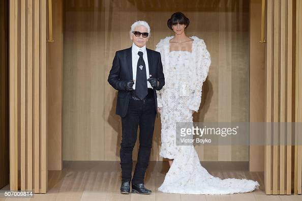 Models pose with Karl Lagerfeld during the finale of the runway at the Chanel Haute Couture Spring Summer 2016 show as part of Paris Fashion Week on...