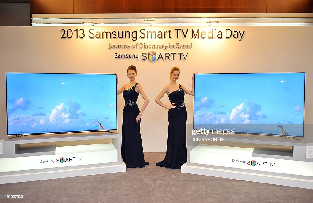 Models pose with Samsung Electronics' new 75 inch F8000 Smart LED TV during a media conference in Seoul on February 19, 2013. South Korea's Samsung Electronics on February 19 launched a set of giant, Internet-enabled televisions aimed at boosting profit margins and cementing its lead on the world's TV markets hit by slowing global demand.
