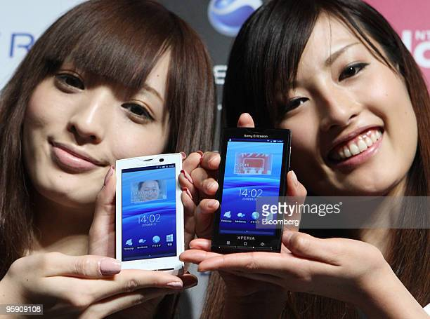 Models pose with Xperia smart phones during the launch held by Sony Ericsson Mobile Communications AB and NTT DoCoMo Inc in Tokyo Japan on Thursday...