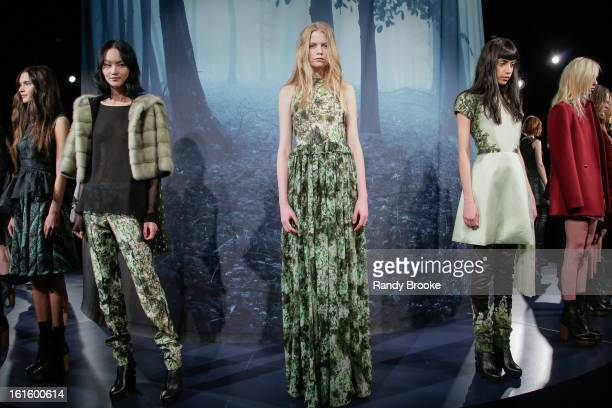 Models poses at the Adeam Fall 2013 presentation during MercedesBenz Fashion Week at The Box at Lincoln Center on February 12 2013 in New York City