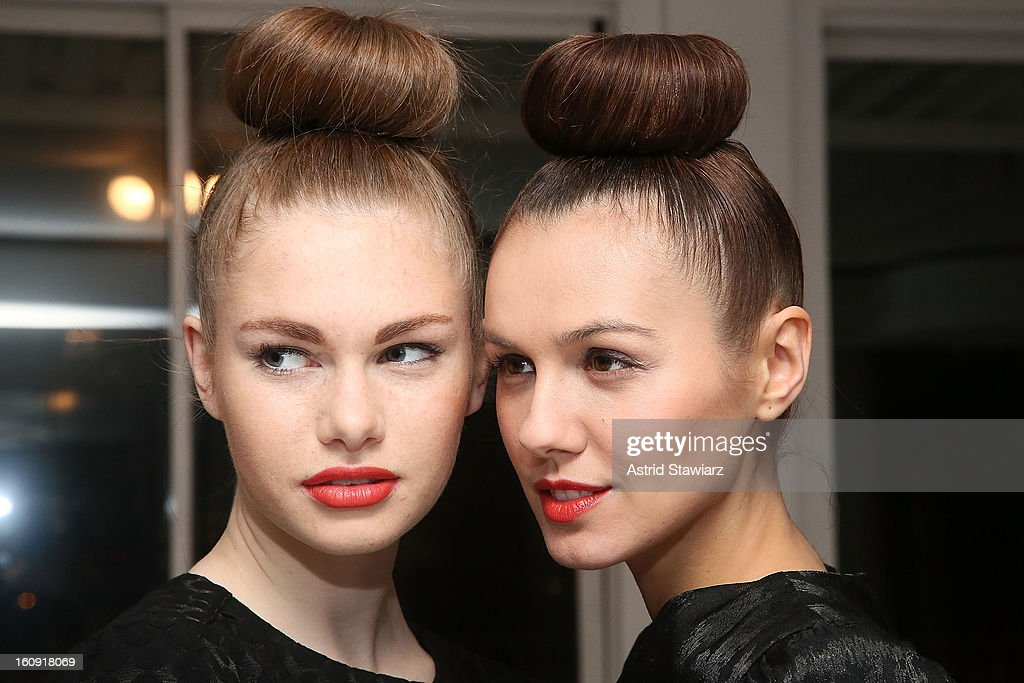 Models poses for photos backstage at the Ivana Helsinki fall 2013 Fashion show during Mercedes-Benz Fashion Week at Studio 450 on February 7, 2013 in New York City.
