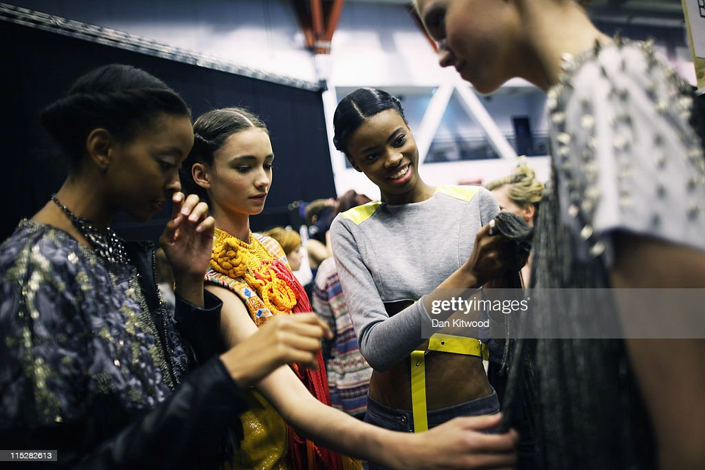 Models prepaer backstage during Graduate Fasdhion Week at Earls Court on June 6, 2011 in London, England. The event which began in 1991 showcases emerging talent from BA Graduate fashion design courses across the UK, and includes exhibition stands and catwalk shows from around 50 universities.