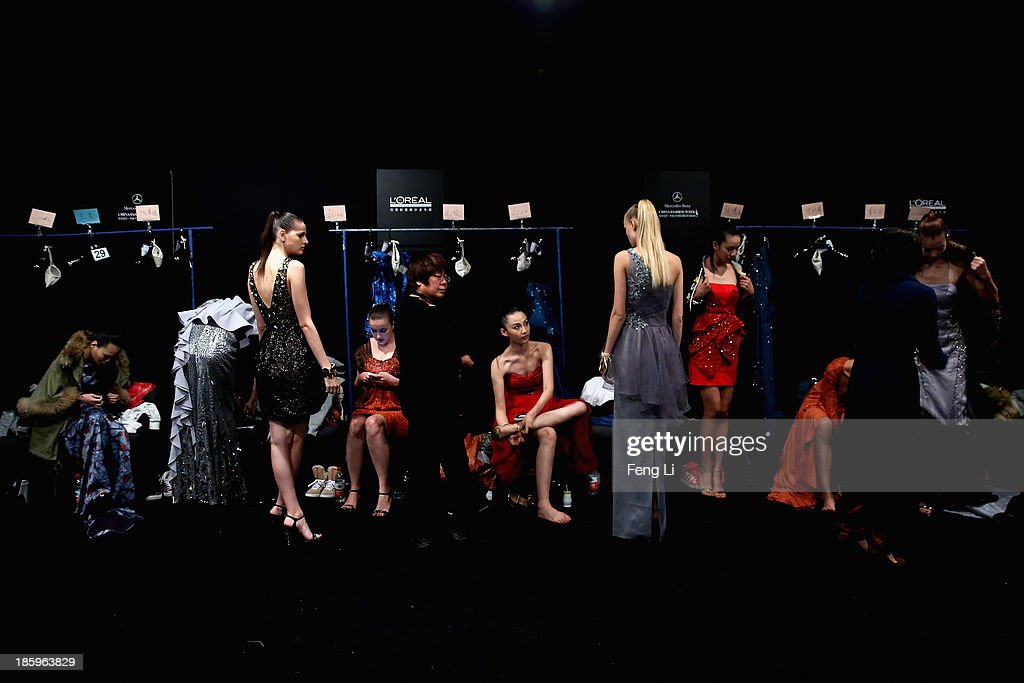Models prepare backstage ahead of STELLA LAM Lin Ruoping Dress Collection show during Mercedes-Benz China Fashion Week Spring/Summer 2014 at 751 D-PARK Workshop on October 26, 2013 in Beijing, China.