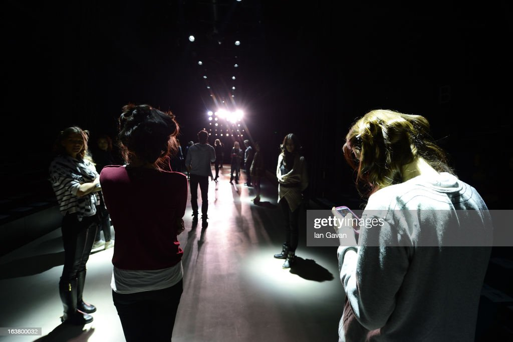 Models prepare backstage ahead of the Best of Mercedes-Benz Fashion Week Istanbul Fall/Winter 2013/14 at Antrepo 3 on March 16, 2013 in Istanbul, Turkey.