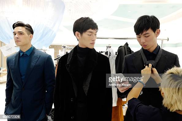 Models prepare backstage ahead of the CERRUTI 1881 show during the Front Row at Shoppes at Parisian on September 16 2016 in Macau Macau