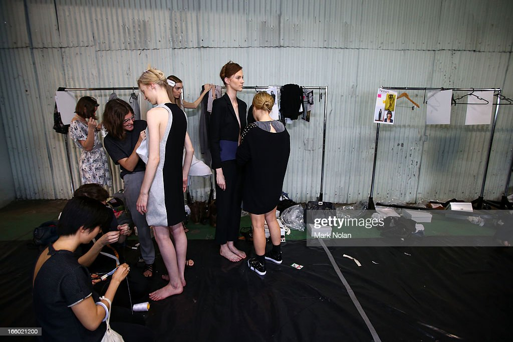 Models prepare backstage ahead of the Christopher Esber show during Mercedes-Benz Fashion Week Australia Spring/Summer 2013/14 at 10 Carrington Street, Marrickville on April 8, 2013 in Sydney, Australia.