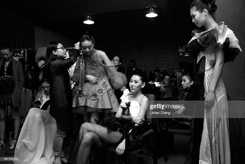 Models prepare backstage ahead of the First Master Training Camp Collection Show on the fifth day of China Graduate Fashion Week at 751D.PARK Central Hall on April 28, 2013 in Beijing, China.