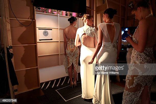 Models prepare backstage ahead of the Red Carpet show during MercedesBenz Fashion Festival Sydney 2015 at Sydney Town Hall on September 26 2015 in...