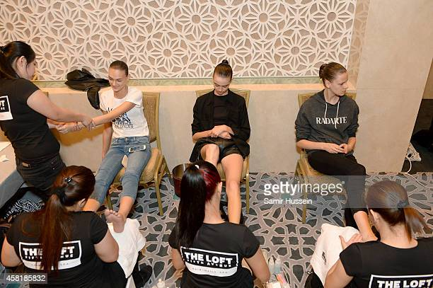 Models prepare backstage ahead of the runway show during the Vogue Fashion Dubai Experience on October 30 2014 in Dubai United Arab Emirates