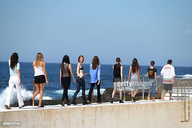 Models prepare backstage ahead of the Ten Pieces show at MercedesBenz Fashion Week Australia 2015 at Bondi Icebergs on April 16 2015 in Sydney...