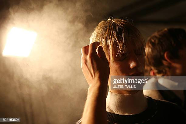 TOPSHOT Models prepare backstage ahead of the Tiger of Sweden catwalk show on the second day of the Autumn/Winter 2016 London Collections Men fashion...