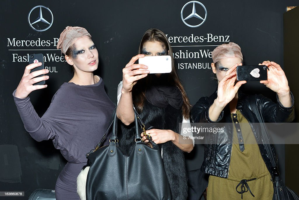 Models prepare backstage ahead of the Tuba Ergin show during Mercedes-Benz Fashion Week Istanbul Fall/Winter 2013/14 at Antrepo 3 on March 14, 2013 in Istanbul, Turkey.