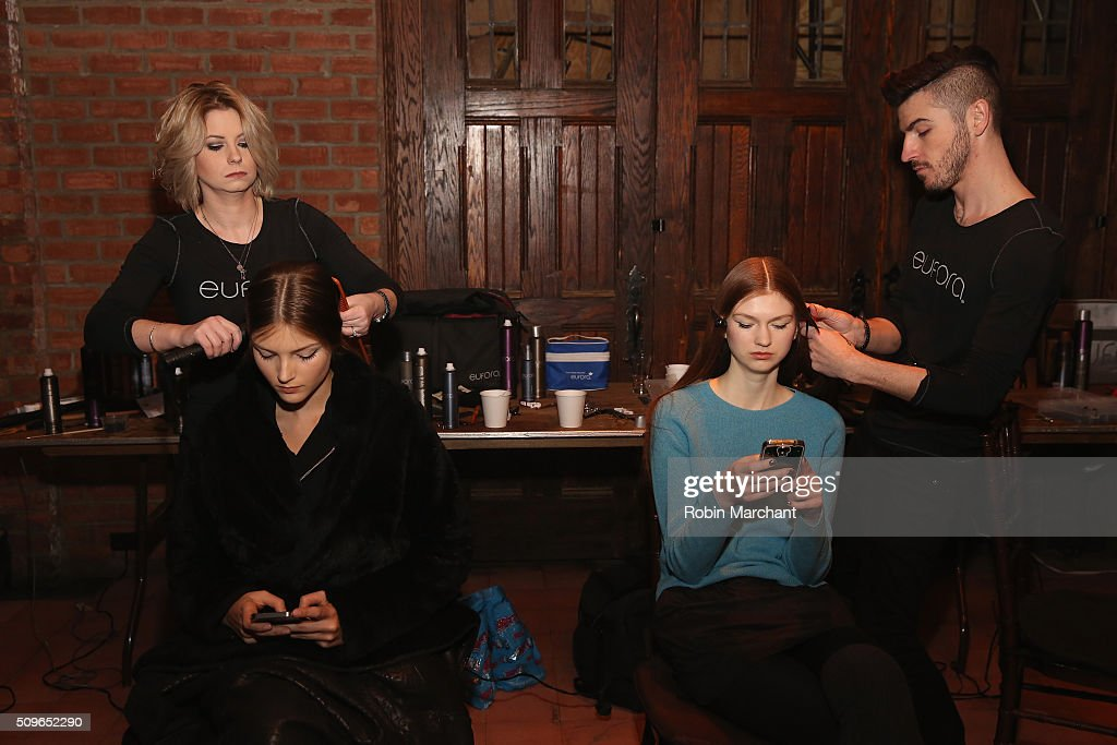 Models prepare backstage at Katie Ermilio presentation during Fall 2016 New York Fashion Week: The Shows at Bowery Hotel Rooftop on February 11, 2016 in New York City.