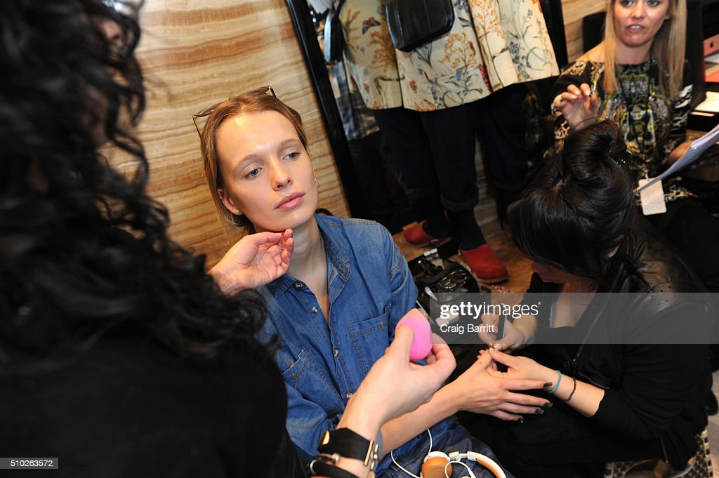 Models prepare backstage at Mary Kay at Tracy Reese F/W '16- Presentation during New York Fashion Week at Roxy Hotel on February 14, 2016 in New York City.
