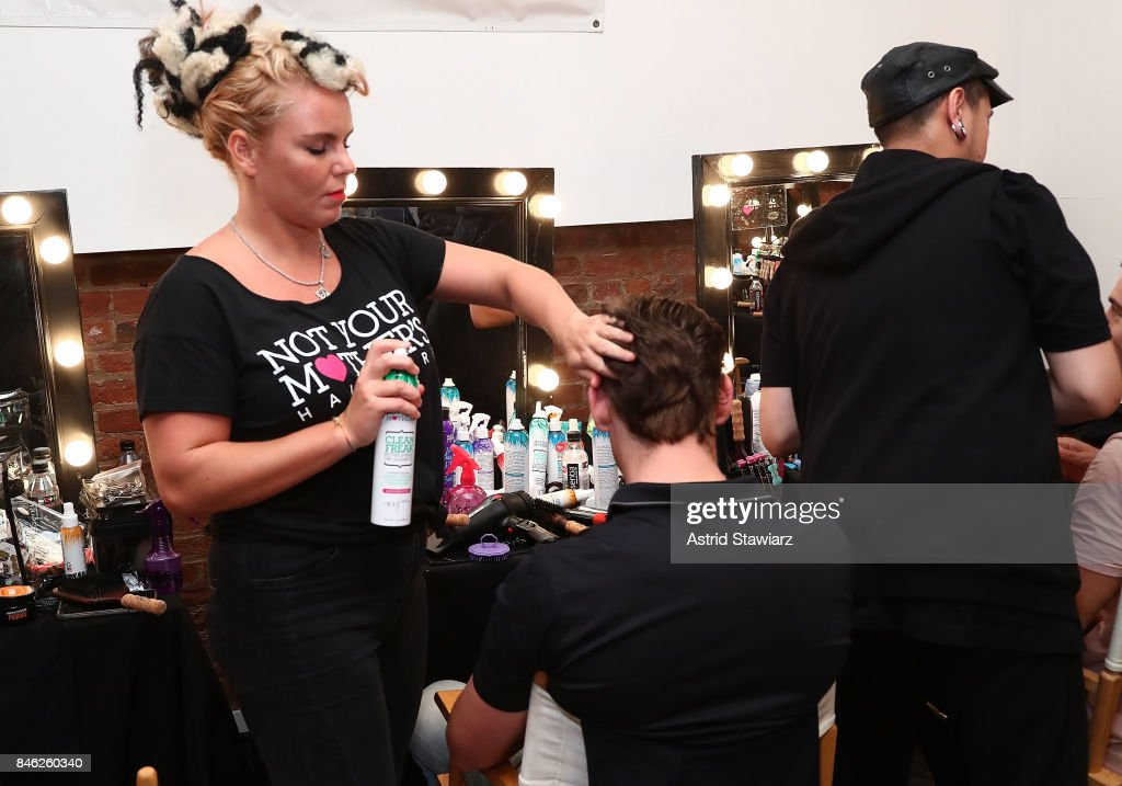 Models prepare backstage at Momentum By Timo Weiland during New York Fashion Week at Metropolitan West on September 12, 2017 in New York City.