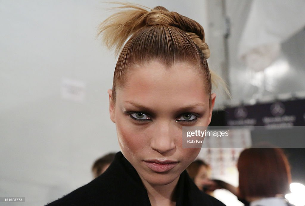 Models prepare backstage at Nanette Lepore during Fall 2013 Mercedes-Benz Fashion Week at The Stage at Lincoln Center on February 13, 2013 in New York City.