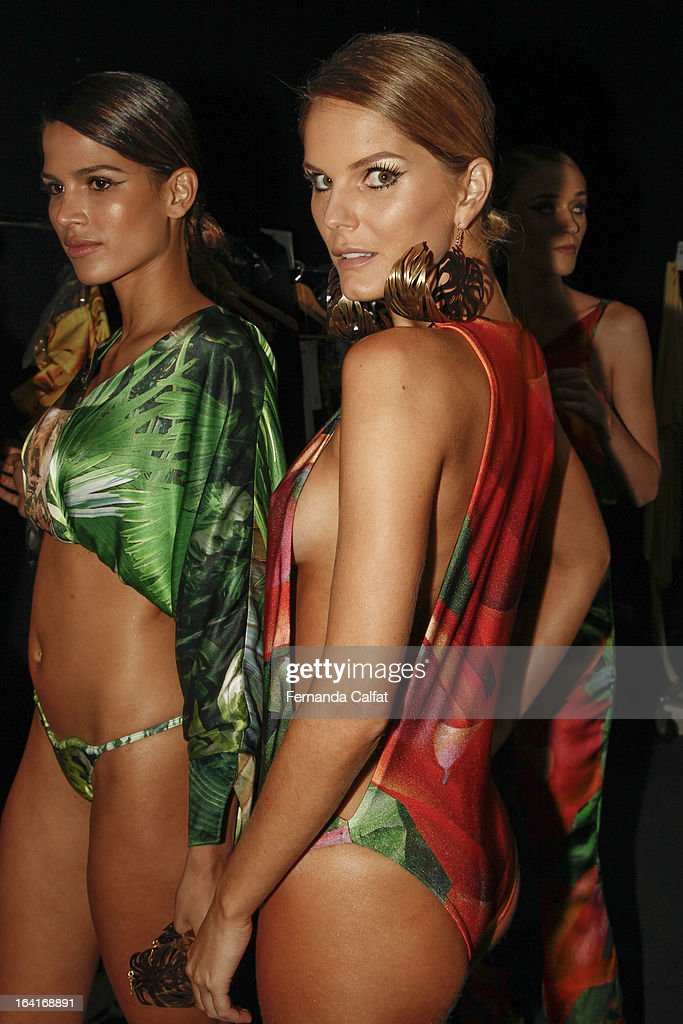 Models prepare backstage at the Agua de Coco show during Sao Paulo Fashion Week Summer 2013/2014 on March 20, 2013 in Sao Paulo, Brazil.